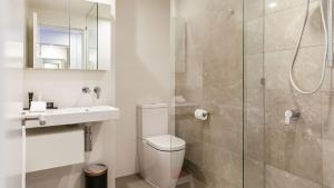 A bathroom at Arise Ruby Collection