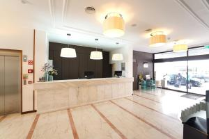 Hol lub recepcja w obiekcie Legendary Lisboa Suites