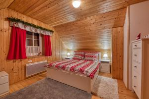 Postel nebo postele na pokoji v ubytování CHALUPA NA VYHLÍDCE