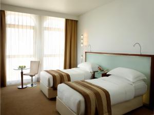 Un ou plusieurs lits dans un hébergement de l'établissement Villa Rotana - Dubai