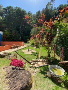 Jardín al aire libre en Apartamento Para 5 em Jurerê Florianópolis