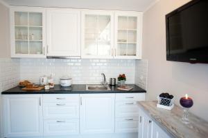 A kitchen or kitchenette at Apartamenty Górska Legenda