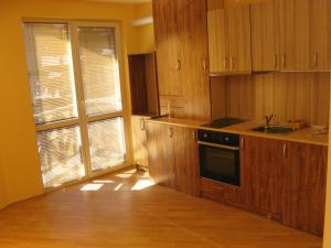 A kitchen or kitchenette at Apartments Borovets
