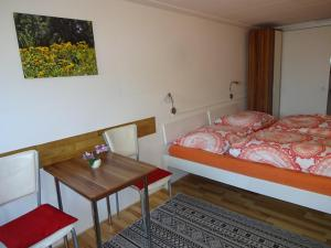 A bed or beds in a room at Ferienwohnung Kretschmer