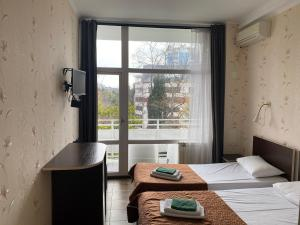 A bed or beds in a room at Subbota Apartments