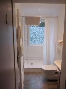 Ein Badezimmer in der Unterkunft Travel Apartments