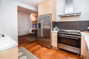 A kitchen or kitchenette at Luxurious Private Villa