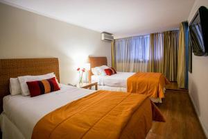 Cama o camas de una habitación en La Sebastiana Suites