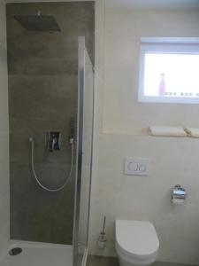 Ein Badezimmer in der Unterkunft City Apartment Amadeus