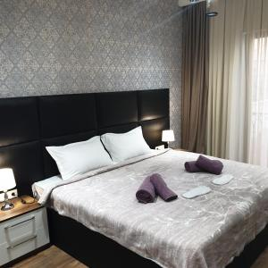 A bed or beds in a room at Apartments - Mari`El