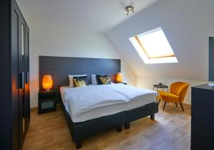 A bed or beds in a room at Le fond d'Or