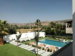 A view of the pool at Villa Zoe or nearby