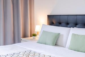 Cama o camas de una habitación en Gracia Bas Apartments Barcelona