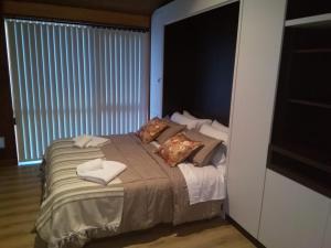 Una cama o camas en una habitación de DEPARTAMENTO DE CATEGORÍA