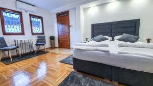 Krevet ili kreveti u jedinici u objektu Herc Apartments