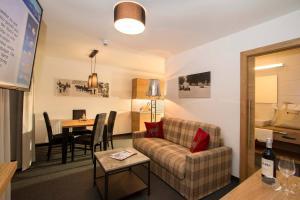 Ein Sitzbereich in der Unterkunft Gurglhof Apartmenthaus