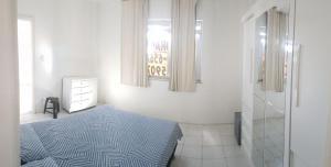 A bed or beds in a room at Apartamento um quarto sala mobiliado no Canela
