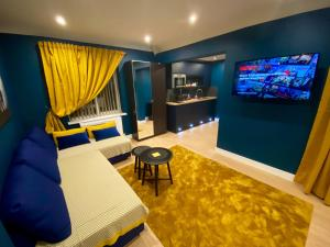 A television and/or entertainment centre at Sky City Apartments