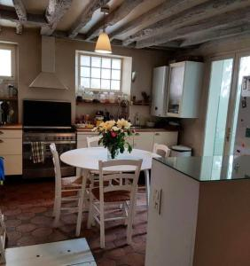 A kitchen or kitchenette at Terraced House with Garden in Oberkampf by GuestReady