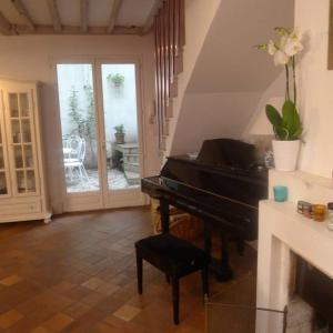 A seating area at Terraced House with Garden in Oberkampf by GuestReady