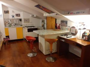 A kitchen or kitchenette at Home 9 Central MI- Porta Venezia