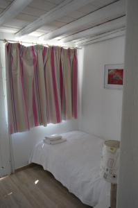 A bed or beds in a room at Sea Side Studios & Houses