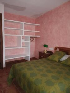 A bed or beds in a room at Masico Santana