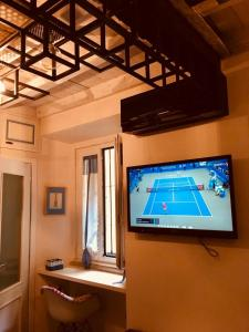 A television and/or entertainment center at Corso Garibaldi Suite