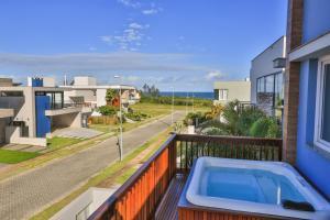 Vista de la piscina de Morada do Mar 2 - Pé na Areia o alrededores
