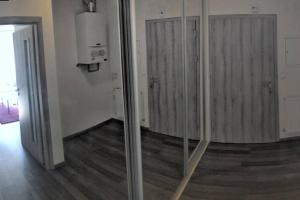 A bathroom at Comfort Apartment with Balcony