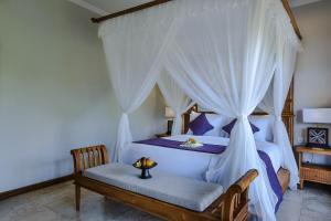 Vuode tai vuoteita majoituspaikassa Desa Pramana Swan