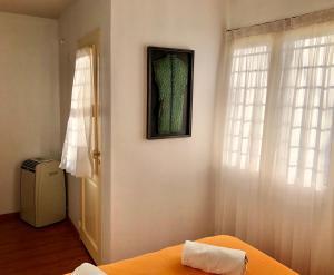 Una cama o camas en una habitación de San Nicolás