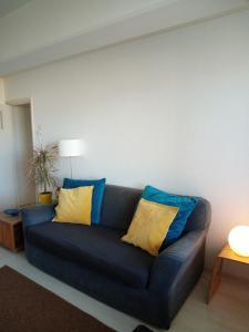 Ein Sitzbereich in der Unterkunft Appartement Zeezicht