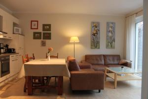Ein Sitzbereich in der Unterkunft Sommer & Jaeger Ferienwohnung