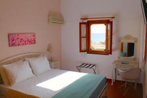 A bed or beds in a room at Cavo Grosso