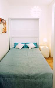 מיטה או מיטות בחדר ב-Herzlich Willkommen - Küss die Hand