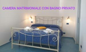 A bed or beds in a room at Rifugio Stellato