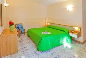 A bed or beds in a room at Casa Vacanze Parco Del Generale