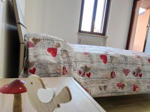 A bed or beds in a room at Appartamento Dolcitalia in Lazise