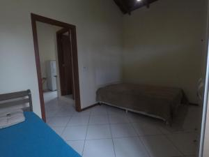 Cama o camas de una habitación en Apartamento Canasvieiras