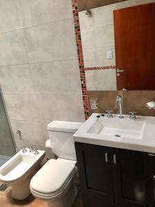 Un baño de Alquiler Temporario Firmat - Libertad