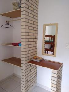A bathroom at Canto dos Pássaros Apartamentos
