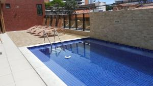 The swimming pool at or close to Excelentes Duplex Maceió