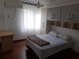 A bed or beds in a room at Apartamento 2700 Camboriu