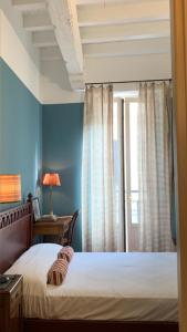 A bed or beds in a room at Corso Garibaldi Suite