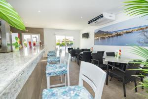 Ein Restaurant oder anderes Speiselokal in der Unterkunft Eix Lagotel
