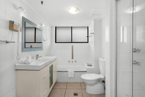 A bathroom at Beachfront Apartment with Balcony, Parking and Pools