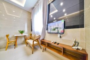 A television and/or entertainment centre at SKYY Garden