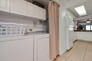 A kitchen or kitchenette at Beachfront Port Aransas Condo w/ Pool Access!