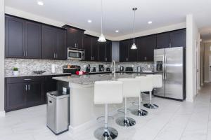 A kitchen or kitchenette at Golf View Vacation Homes